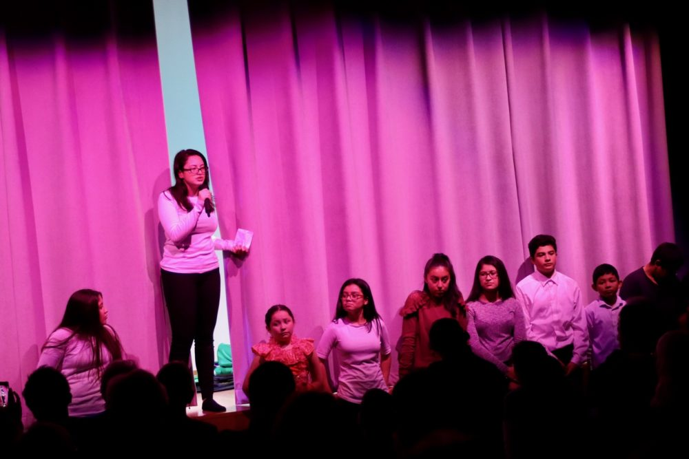 Jacqueline Landaverde, 17, speaks to the audience at the end of the show. (Courtesy Fr. Andrés Araque)