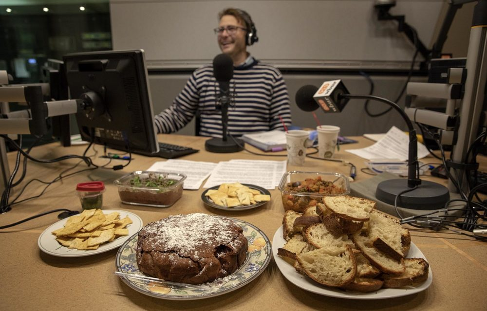 Chef (maybe) Jamie Bologna, in the Radio Boston studio with his cake. (Robin Lubbock/WBUR)