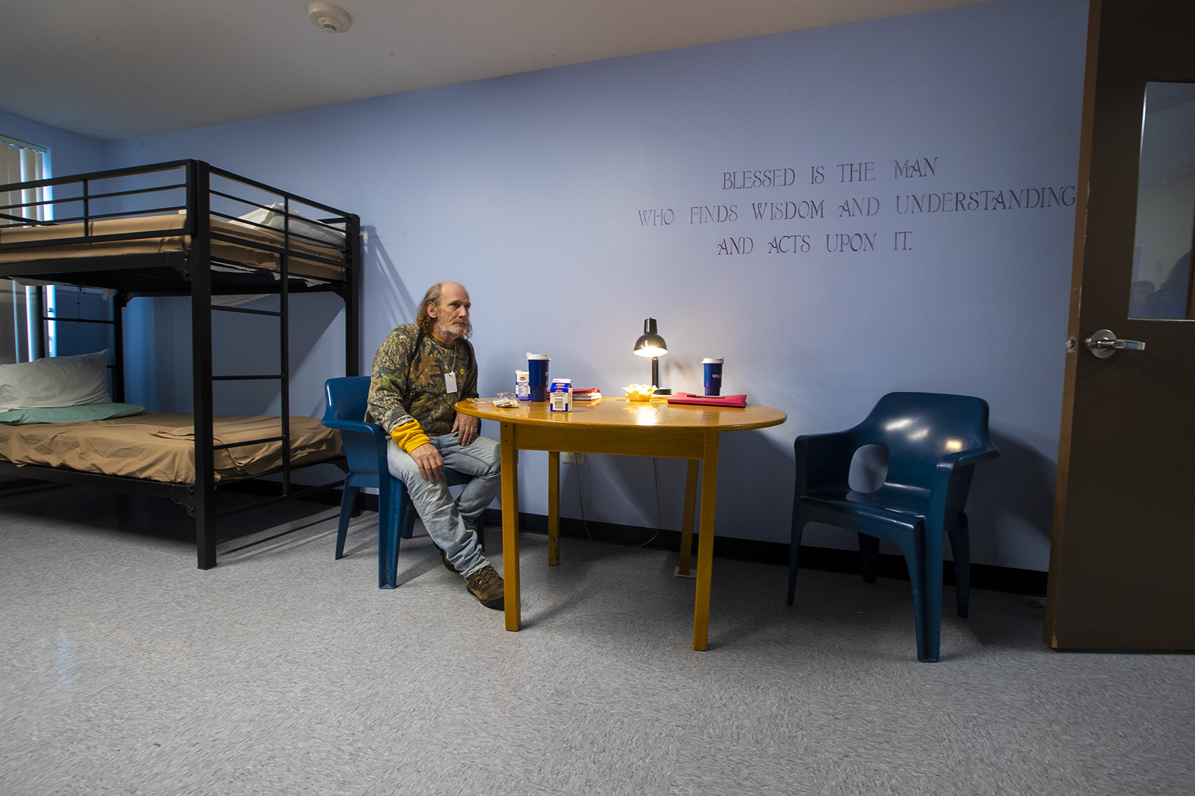 A man sits in his room at the addiction treatment unit at the Hampden County Jail in Ludlow. (Jesse Costa/WBUR)