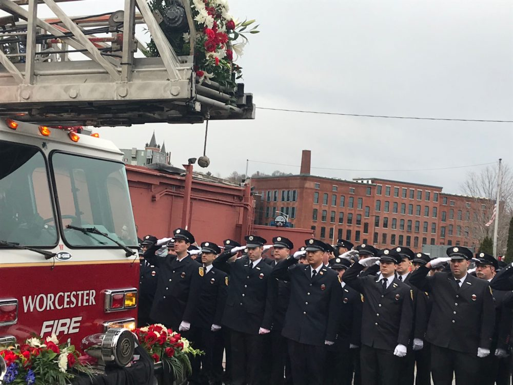 A procession of firefighters lines up in Worcester to pay their respects to fallen firefighter Christopher Roy at his funeral on Saturday. (Quincy Walters/WBUR)