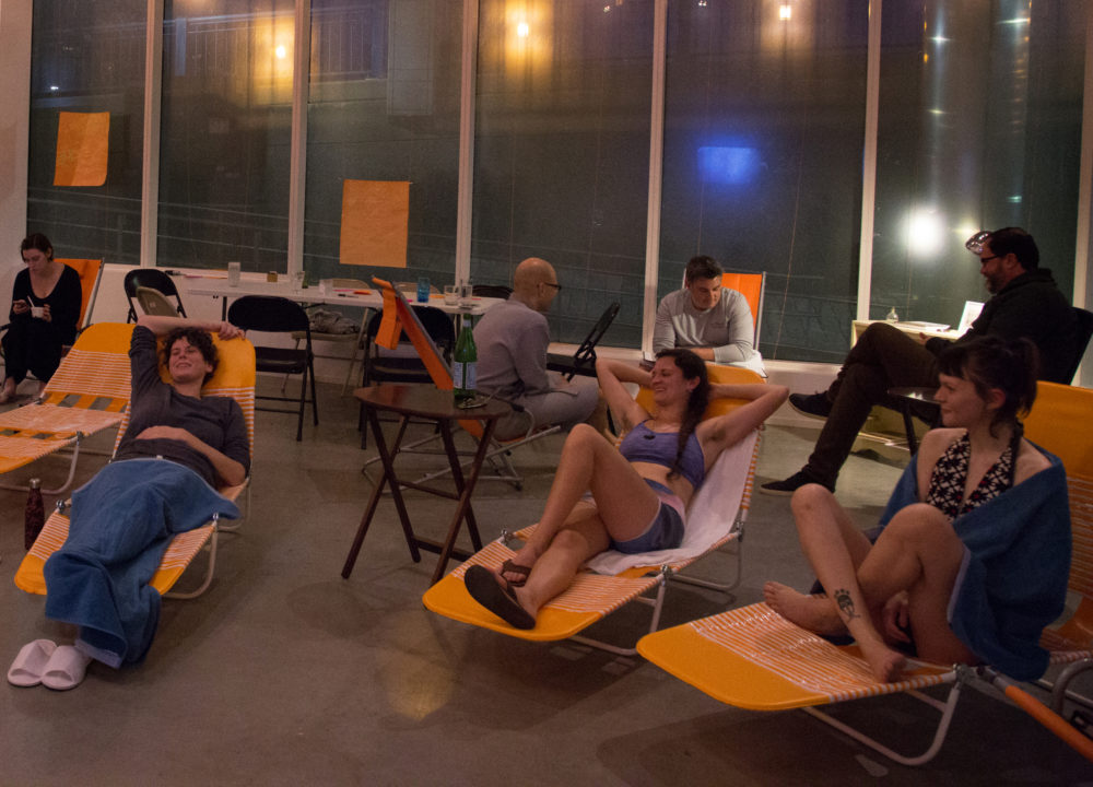 """Participants sit inside """"Sweat It Out's"""" lounge space. (Courtesy Lani Asuncion)"""