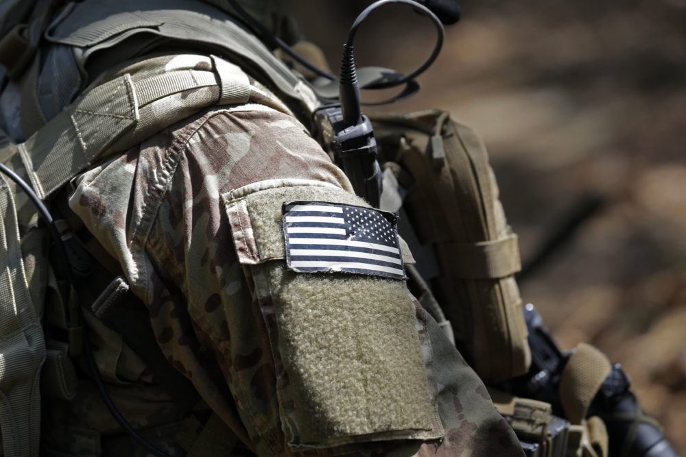 In this photo taken Friday, April 21, 2017 a United States flag patch adorns the uniform of a paratrooper with the 82nd Airborne Division's 3rd Brigade Combat Team during a training exercise at Fort Bragg, N.C. (Gerry Broome/AP)