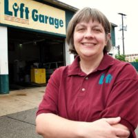 Cathy Heying outside her auto body shop, The Lift. (Courtesy)