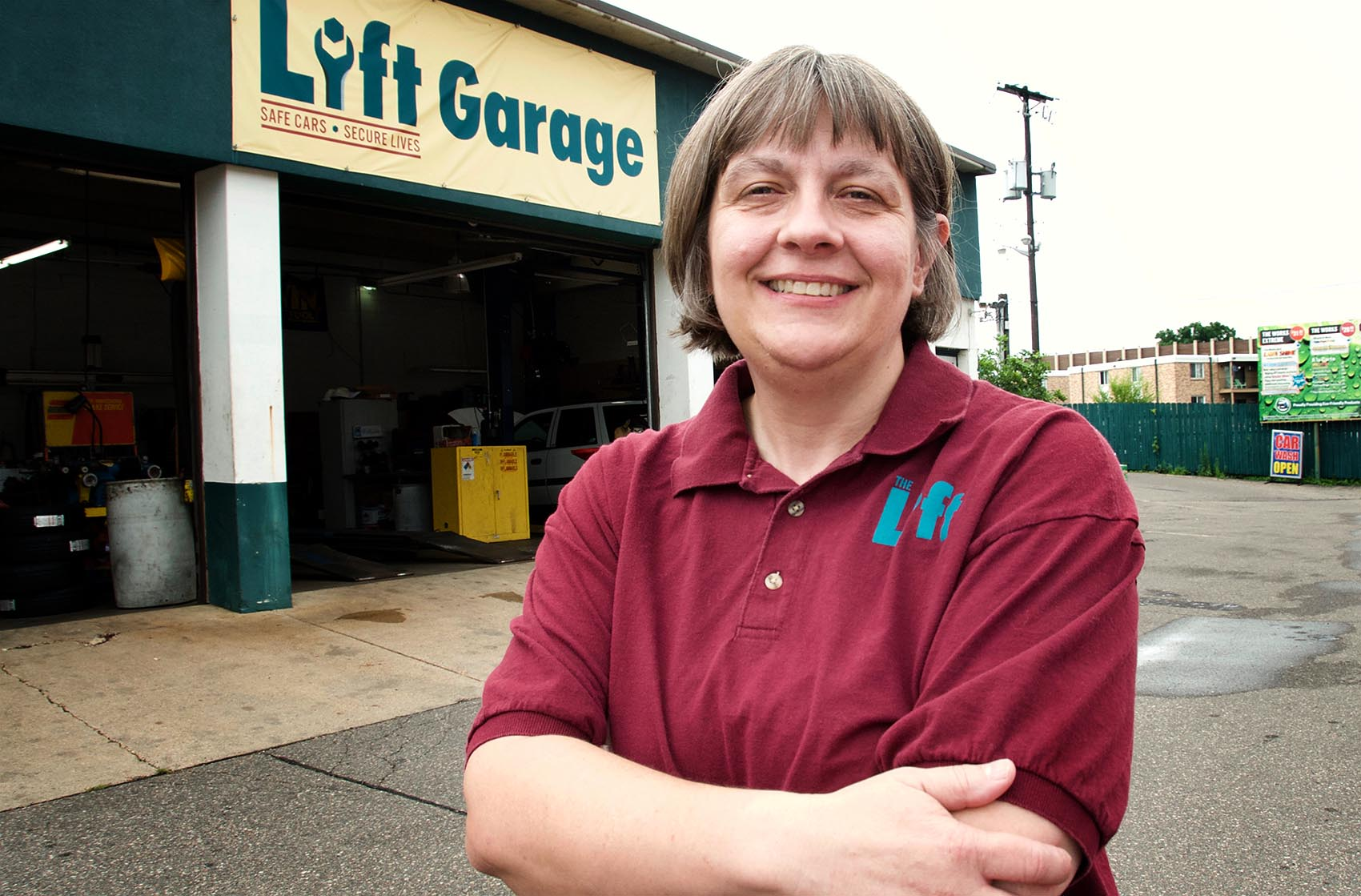Cathy Heying outside her auto body shop, The Lift. (Courtesy Peter Molenda)