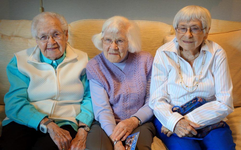 Holocaust survivors Edith Bard (left), Trudy Schwartz (middle) and Esther Adler, at the Orchard Cove Independent Living Facility in Canton, Mass. (Courtesy of John Pregulman)