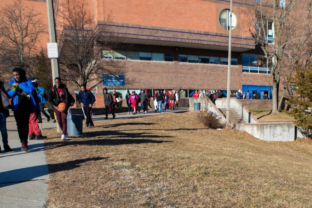 Students leave the West Roxbury Education Complex at the end of the school day. (Jesse Costa/WBUR)