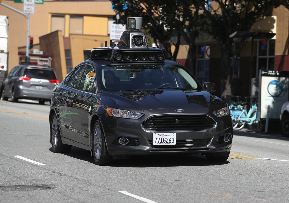 An Uber self-driving car drives down 5th Street in San Francisco. (Justin Sullivan/Getty Images)