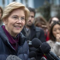 Massachusetts U.S. Sen. Elizabeth Warren talks with reporters outside her home in Cambridge after announcing that she is setting up an exploratory committee for a run for the presidency in 2020. (Robin Lubbock/WBUR)