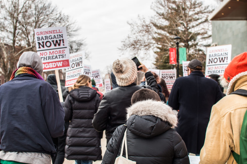Students at Grinnell College in Iowa hold a protest on Dec. 7 in support of expanding the student-workers union. (Courtesy of Paul Chan Htoo Sang/Union of Grinnell Student Dining Workers)