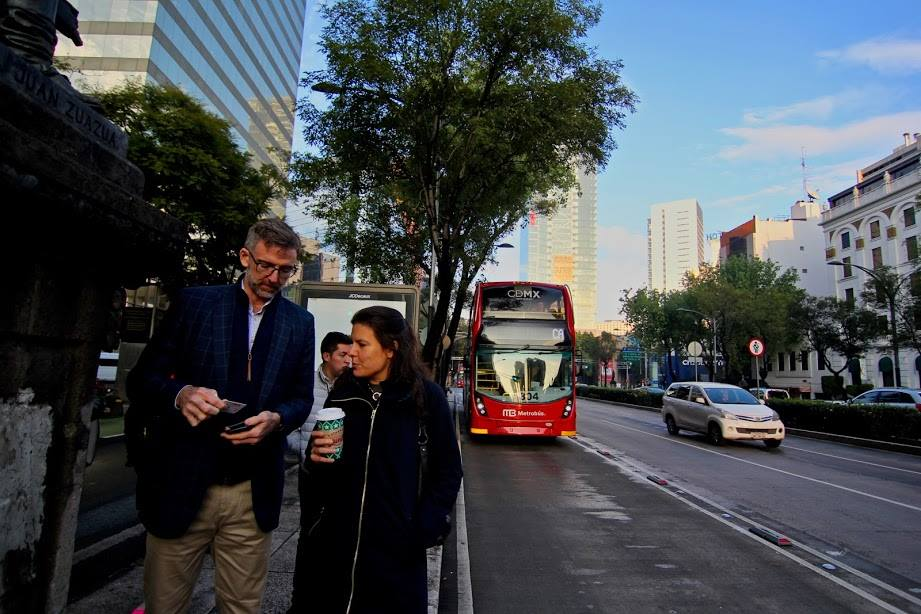 Will Foley of Cushman & Wakefield and Rebecca Leventhal of Higher Ground Labs walk down the street in Mexico City after riding the Metrobus. (Courtesy Alliance for Business Leadership)