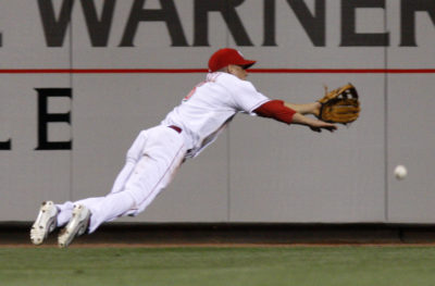 Cincinnati Reds outfielder Ryan Freel dives for a fly ball in a game against the Cleveland Indians on May 16, 2008, in Cincinnati. (David Kohl/AP)