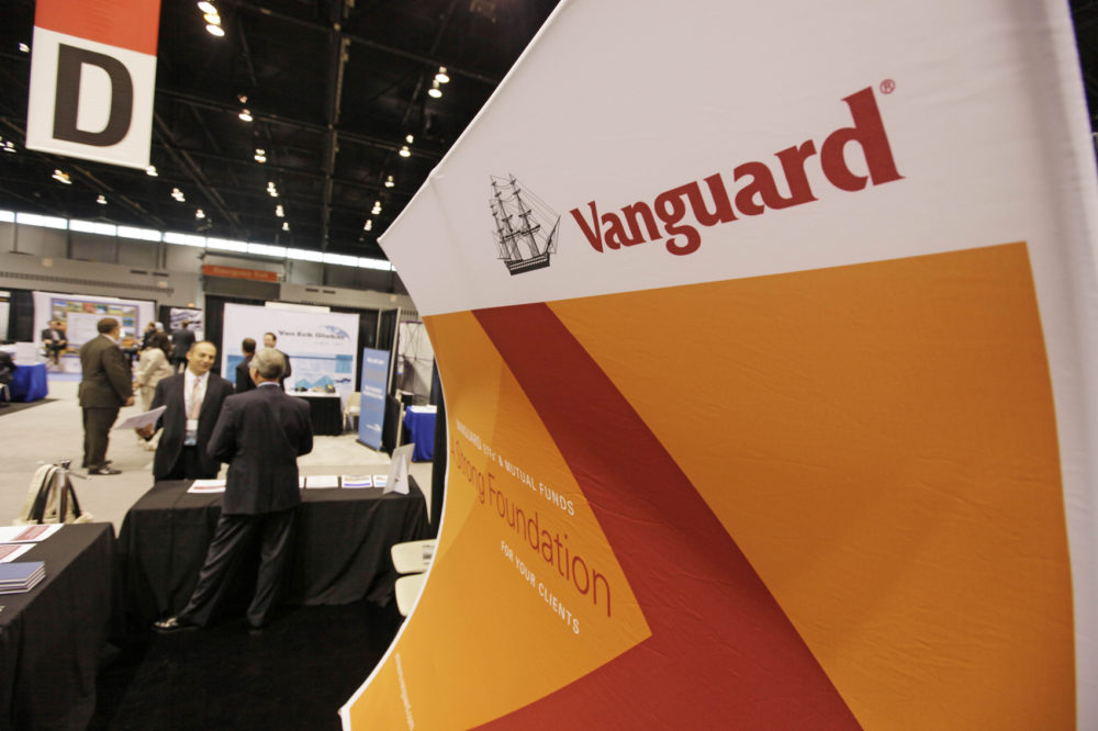An attendee of the 2010 Morningstar Investment Conference speaks with Dave Varrelman, right, a sales associate with Vanguard at the McCormick Center, Thursday, June 24, 2010, in Chicago. (AP Photo/M. Spencer Green)
