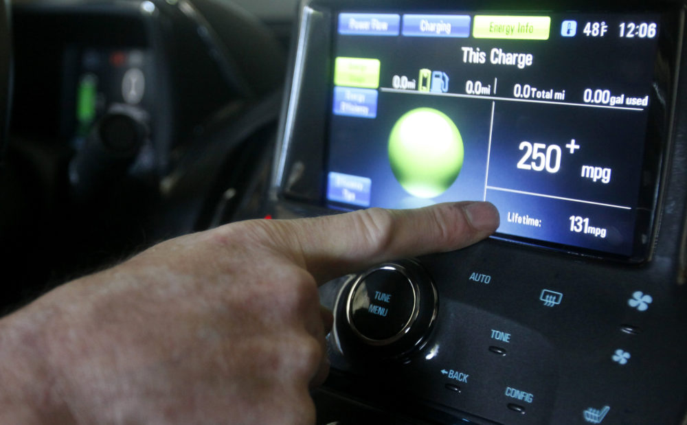 Felix Kramer, founder of CalCars, points to the miles per gallon displayed in his new Chevy Volt electric car in Redwood City, Calif., Wednesday, Dec. 29, 2010. (AP Photo/Jeff Chiu)