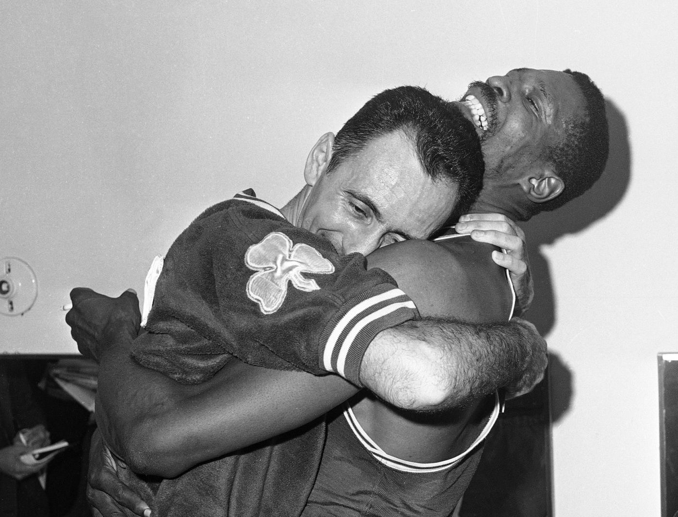 Bob Cousy and Bill Russell celebrate their 1963 NBA title. (Ed Widdis/AP)