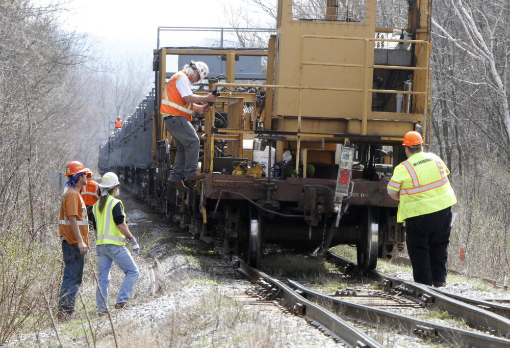 In this April 2011 file photo, workers install new track in Richmond, Vt., the result of upgrades to 220 miles of New England Central Railroad track funded in 2010 by a $50 million federal stimulus grant. A similar grant will be given to Massachusetts for updates to freight rail in the Western part of the state (Toby Talbot/AP File Photo)