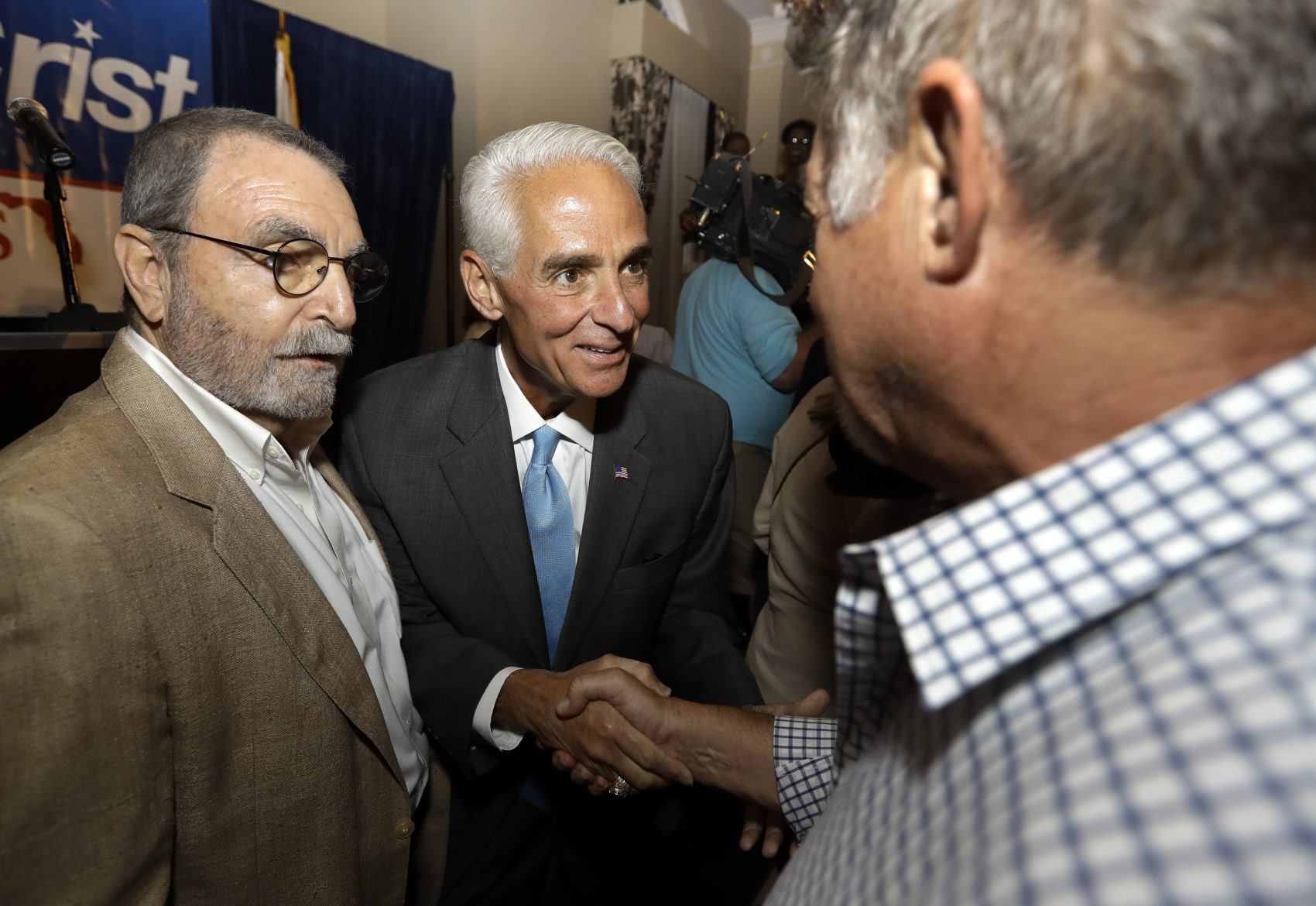 Rep. Charlie Crist, D-Fla., center, shakes hands with supporters after being elected to the U.S. House of Representatives Tuesday, Nov. 8, 2016, in St. Pete Beach, Fla. (Chris O'Meara/AP)
