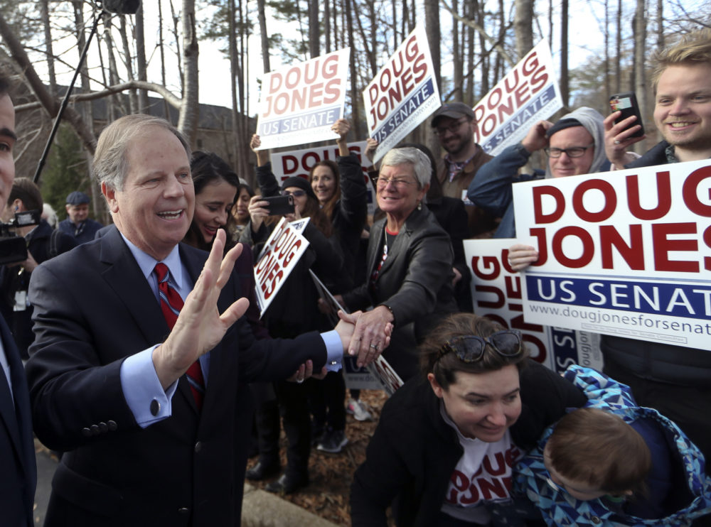 Democratic candidate Doug Jones greets supporters after casting his ballot Tuesday, Dec. 12, 2017, in Mountain Brook , Ala. (John Bazemore/AP)