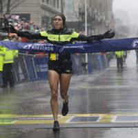 Desiree Linden crosses the finish line to win the women's division of the 122nd Boston Marathon on April 16, 2018. Linden is the first American woman to win the race since 1985. (Elise Amendola/AP)