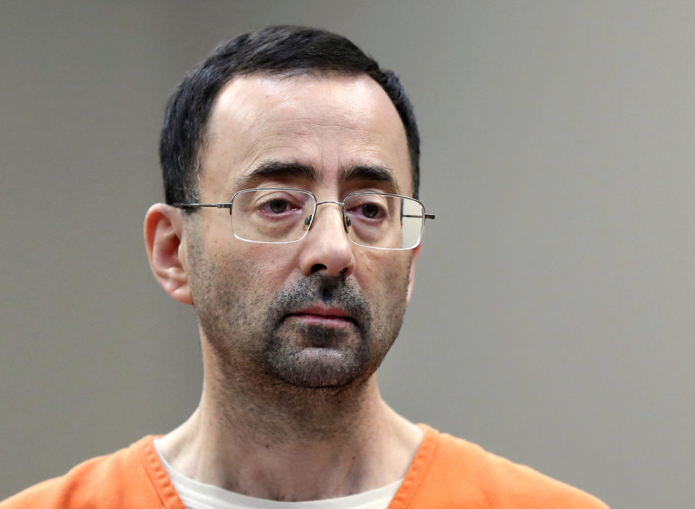 In this Nov. 22, 2017, file photo, Larry Nassar, a sports doctor accused of molesting girls while working for USA Gymnastics and Michigan State University appears in court in Lansing, Mich., where he pleaded guilty to multiple charges of sexual assault. (Paul Sancya/AP)