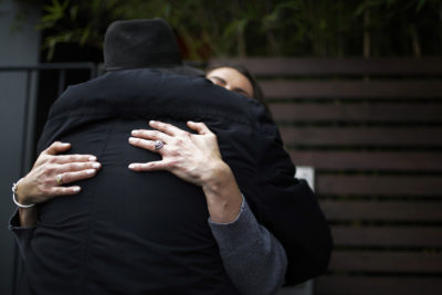 Peter Peacock, foreground, and Gypsy Diamond, 36, hug each other before parting ways after their second meeting, in Melbourne, Australia, Thursday, May 17, 2018. Peacock, who donated sperm anonymously around 1980, was recently contacted by Diamond, his biological daughter, after a new law in Australia retroactively removed the anonymity granted to sperm donors decades ago. (Wong Maye-E/AP)