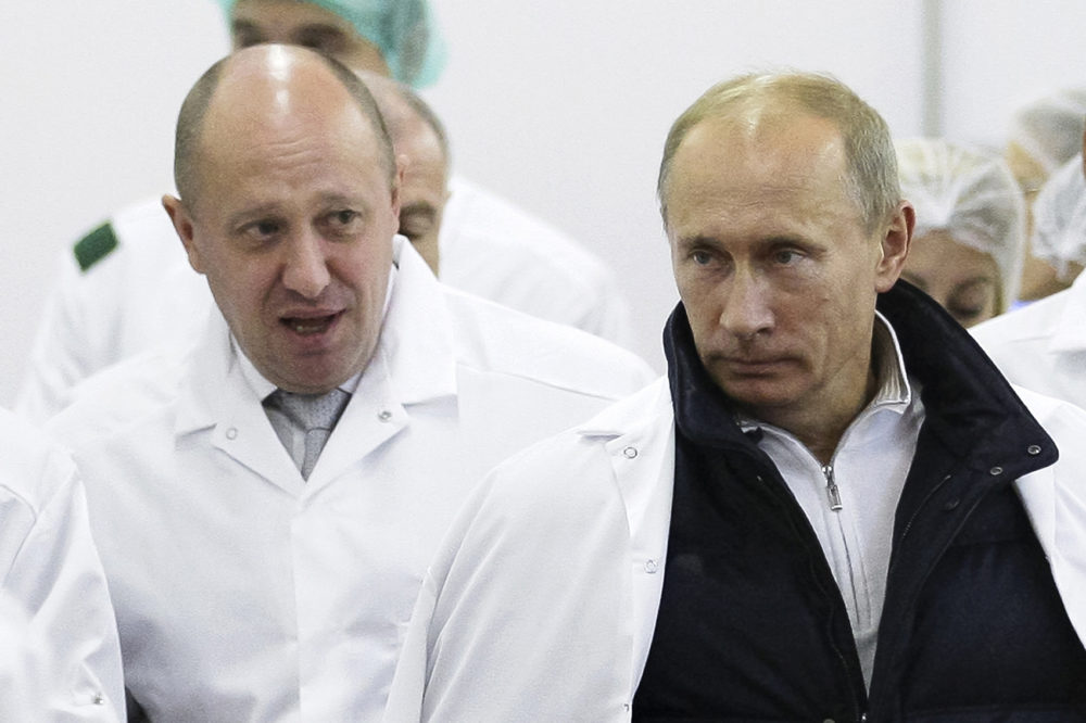 Businessman Yevgeny Prigozhin, left, shows Russian President Vladimir Putin, around his factory which produces school means, outside St. Petersburg, Russia, Sept. 20, 2010. (Alexei Druzhinin/Pool Photo via AP, File)