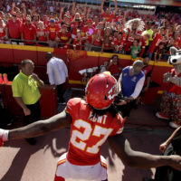 Kansas City Chiefs running back Kareem Hunt (27) celebrates with fans after an NFL football game against the San Francisco 49ers, Sunday, Sept. 23, 2018, in Kansas City, Mo. (Charlie Riedel/AP)