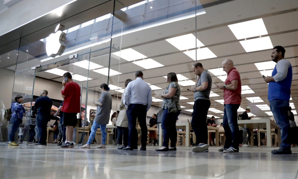 In this Sept. 21, 2018, file photo customers wait in line outside of the Apple Store at the Garden State Plaza on the day the new iPhone XS and iPhone XS Max were released in Paramus, N.J. (Julio Cortez/AP)