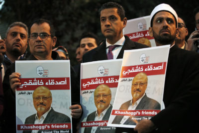 Activists protesting the killing of Saudi journalist Jamal Khashoggi hold a candlelight vigil outside Saudi Arabia's consulate in Istanbul, Thursday, Oct. 25, 2018. The posters read in Arabic:' Khashoggi's Friends Around the World'. (Lefteris Pitarakis/AP)