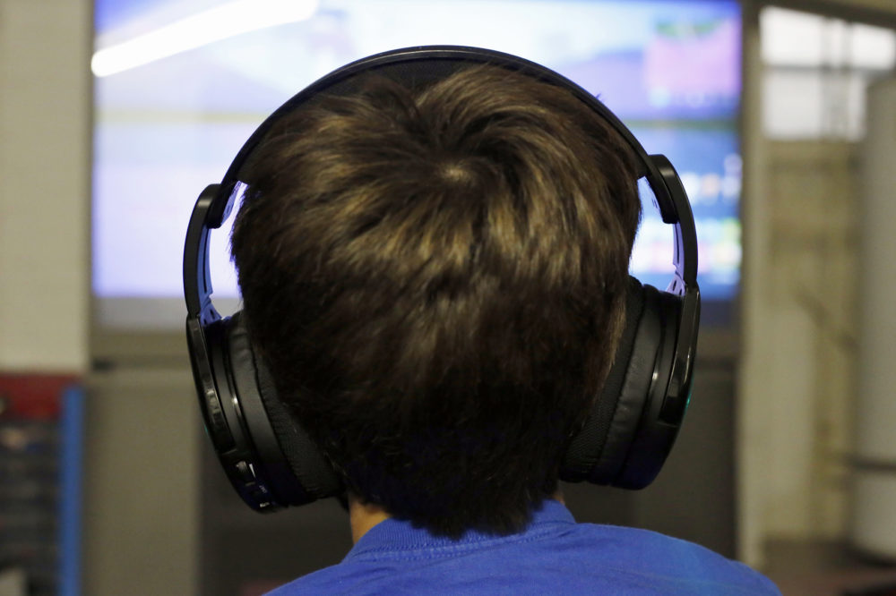 Henry Hailey, 10, plays Fortnite in the early morning hours in the basement of his Chicago home on Saturday, Oct. 6, 2018. His parents are on a quest to limit screen time for him and his brother. The boys say they understand sometimes, but also complain that they get less screen time than their friends. (Martha Irvine/AP)