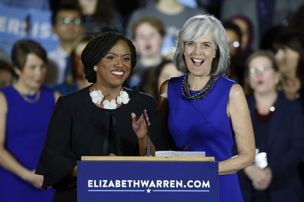 Congresswoman-elect Ayanna Pressley, D-Mass., left, stands with U.S. Rep. Katherine Clark, D-Mass., during an election night watch party in Boston, Tuesday, Nov. 6, 2018. (Michael Dwyer/AP)