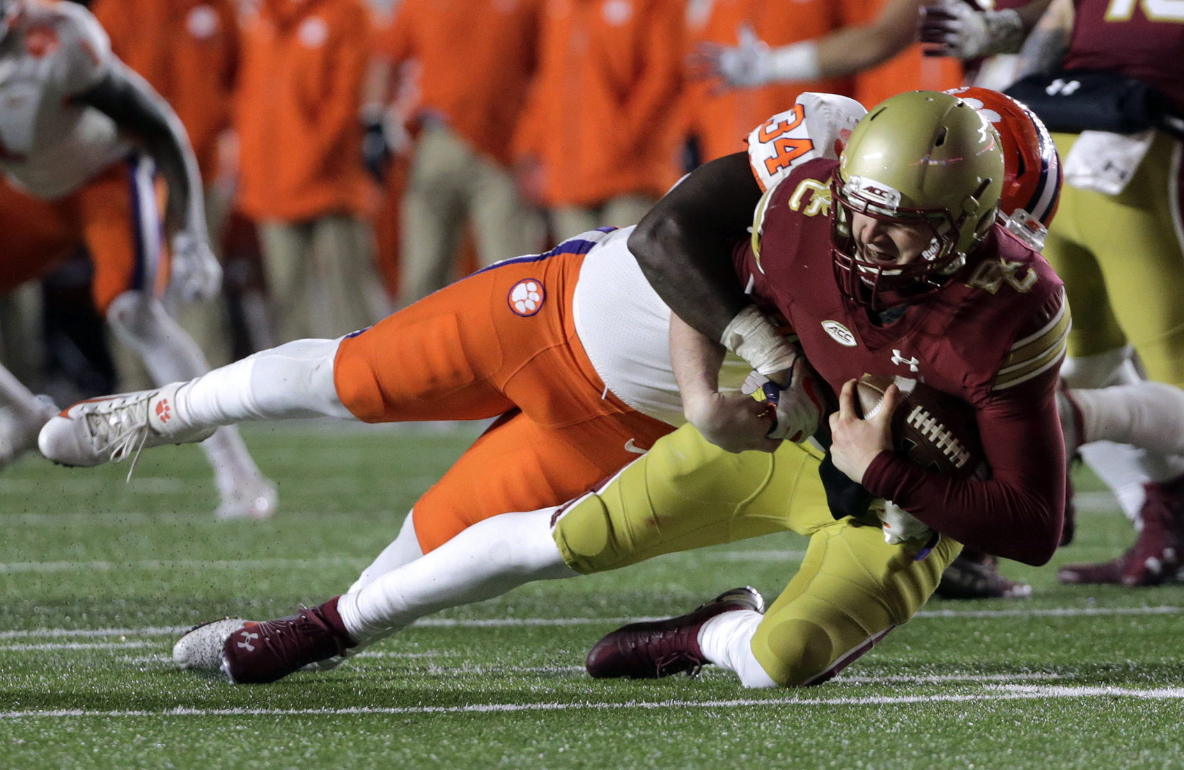 Clemson linebacker Kendall Joseph, sacked Boston College quarterback EJ Perry when the Tigers beat the Eagles in November. BC and Clemson will earn money from their bowl-game appearances. (AP Photo/Elise Amendola)