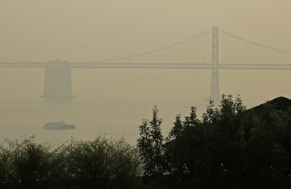A ferryboat and the San Francisco-Oakland Bay Bridge are obscured due to smoke and haze from wildfires Monday, Nov. 19, 2018, in San Francisco. (Eric Risberg/AP)