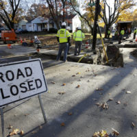 On Nov. 8, natural gas contract workers repair underground gas lines in Lawrence. (Steven Senne/AP)