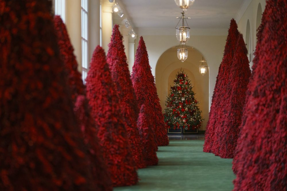 Topiary trees line the East colonnade during the 2018 Christmas Press Preview at the White House in Washington, Monday, Nov. 26, 2018. (Carolyn Kaster/AP)
