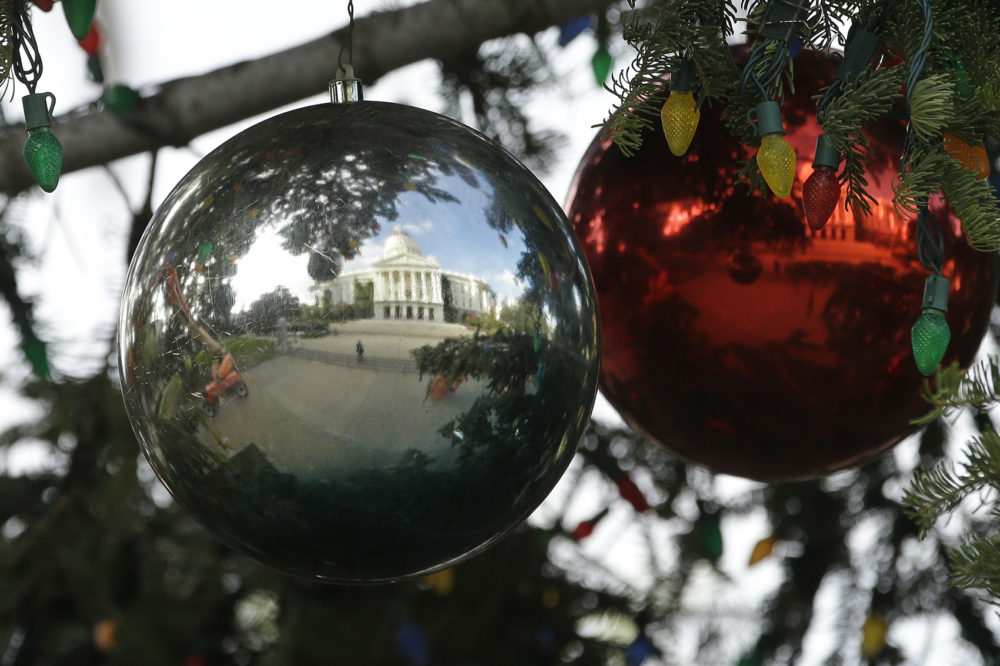 The Capitol Christmas Tree is reflected in one of the hundreds of ornaments decorating the tree Wednesday, Nov. 28, 2018, in Sacramento, Calif. (Rich Pedroncelli/AP)