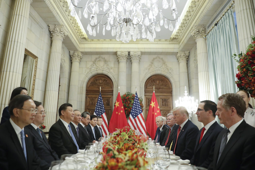 President Donald Trump, right, China's President Xi Jinping, left, and members of their delegations during their bilateral meeting at the G-20 Summit, Saturday, Dec. 1, 2018 in Buenos Aires, Argentina. (AP Photo/Pablo Martinez Monsivais)