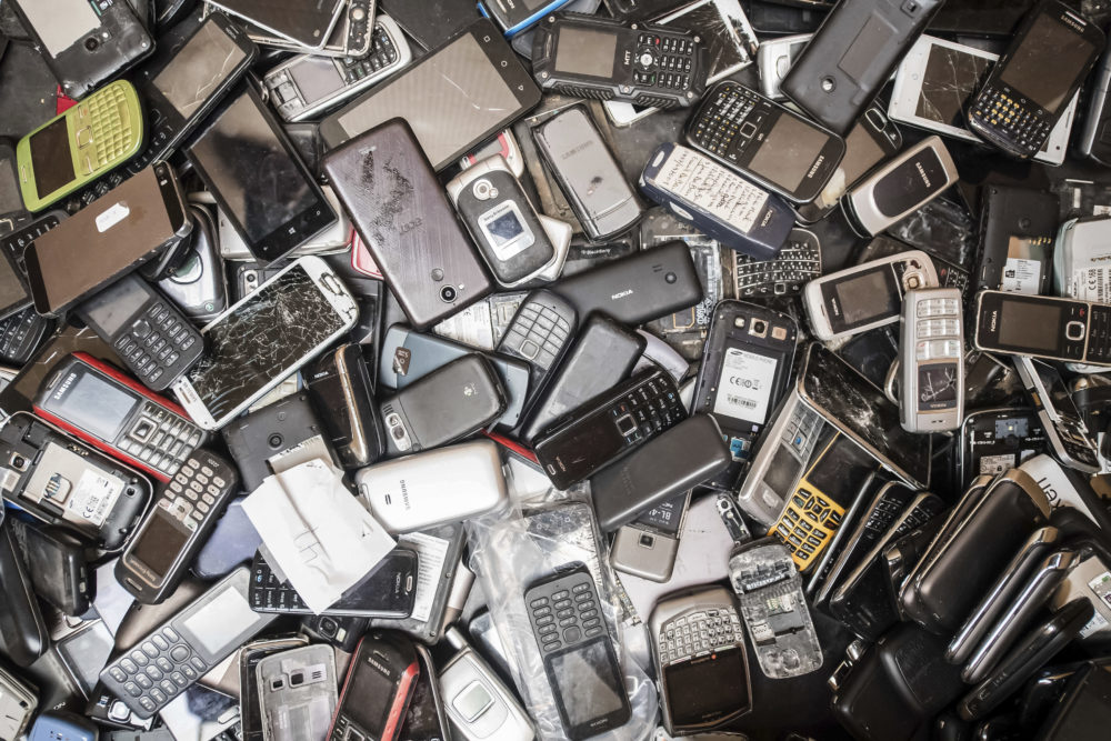 In this photo taken on July 13, 2018, old mobile phones fill a bin at the Out Of Use company warehouse in Beringen, Belgium. European Union nations are expected to produce more than 12 million tons of electronic waste per year by 2020. (Geert Vanden Wijngaert/AP)