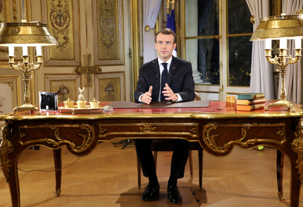 "French President Emmanuel Macron poses before a special address to the nation, his first public comments after four weeks of nationwide ""yellow vest"" protests, at the Elysee Palace, in Paris, on Monday. (Ludovic Marin/AP)"