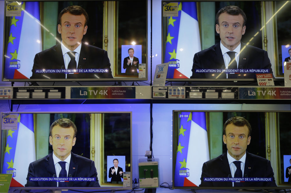 TV screens show French President Emmanuel during a televised address to the nation, at an electrical appliance store in Marseille, southern France, Monday, Dec. 10, 2018. President Emmanuel Macron has acknowledged he's partially responsible for the anger that has fueled weeks of protests in France, an unusual admission for the leader elected last year. (Claude Paris/AP)