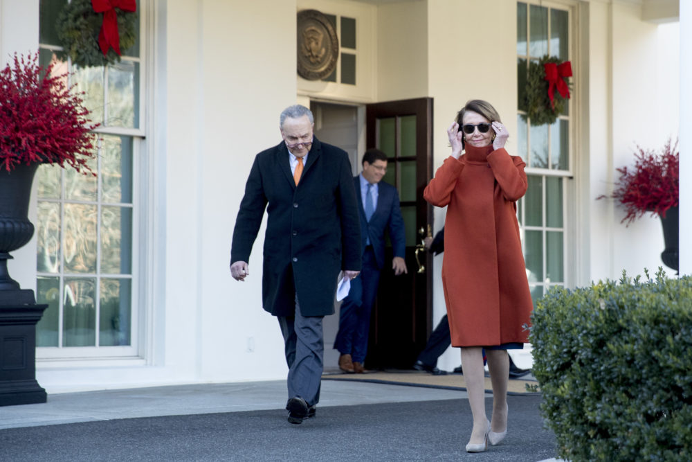 House Minority Leader Nancy Pelosi of Calif., right, and Senate Minority Leader Sen. Chuck Schumer of N.Y., left, walk out of the West Wing to speak to members of the media outside of the White House in Washington, Tuesday, Dec. 11, 2018, following a meeting with President Donald Trump. (Andrew Harnik/AP)