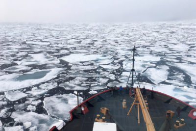 This summer 2018 photo provided by NOAA shows the USCG Icebreaker Healy on a research cruise in the Chukchi Sea of the Arctic Ocean. Scientists are seeing surprising melting in Earth's polar regions at times they don't expect, like winter, and in places they don't expect, like eastern Antarctica. (Devin Powell/NOAA via AP)