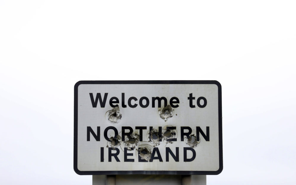 Bullet holes are seen in a sign welcoming people to Northern Ireland on the border between Northern Ireland and the Republic of Ireland, near the town of Derrylin, Northern Ireland, Wednesday, Dec. 12, 2018. (Peter Morrison/AP)