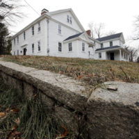In this Thursday, Dec. 13, 2018 photo a wall stands near the home where Sarah Clayes lived, in Framingham, Mass., after leaving Salem, Mass., following the 1692 witch trials.  Clayes was jailed during the witch trials but was freed in 1693 when the hysteria died down. (Steven Senne/AP)
