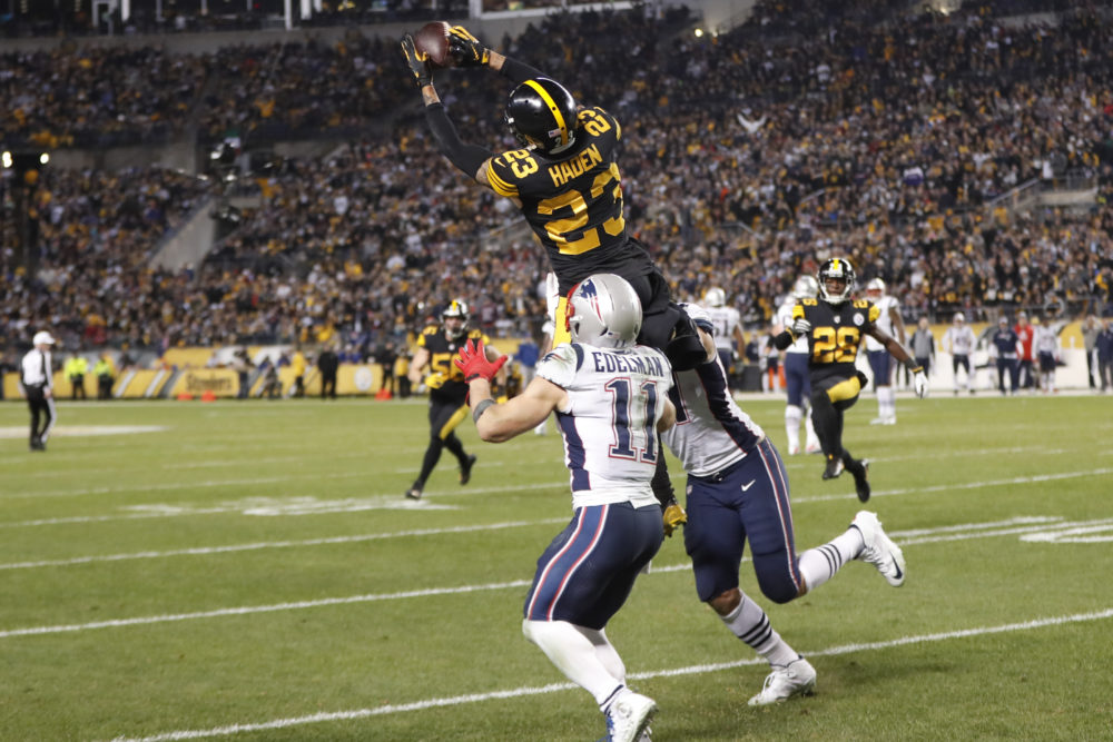 Steelers cornerback Joe Haden intercepts Tom Brady in the fourth quarter. (Keith Srakocic/AP)