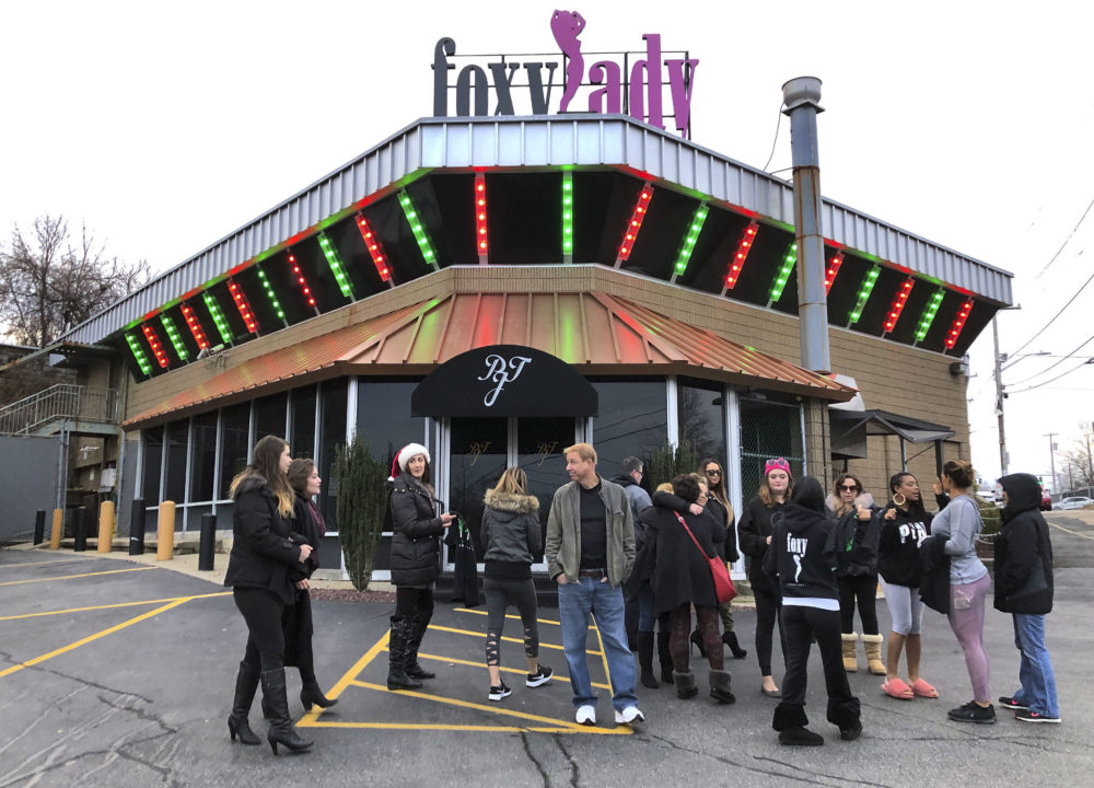 Former workers gather outside the Foxy Lady strip club, Thursday, Dec. 20, 2018, in Providence, R.I. The city ordered the club to close on Wednesday. A city board voted to revoke its licenses after police charged three dancers with prostitution the previous week. (Michelle R. Smith/AP)