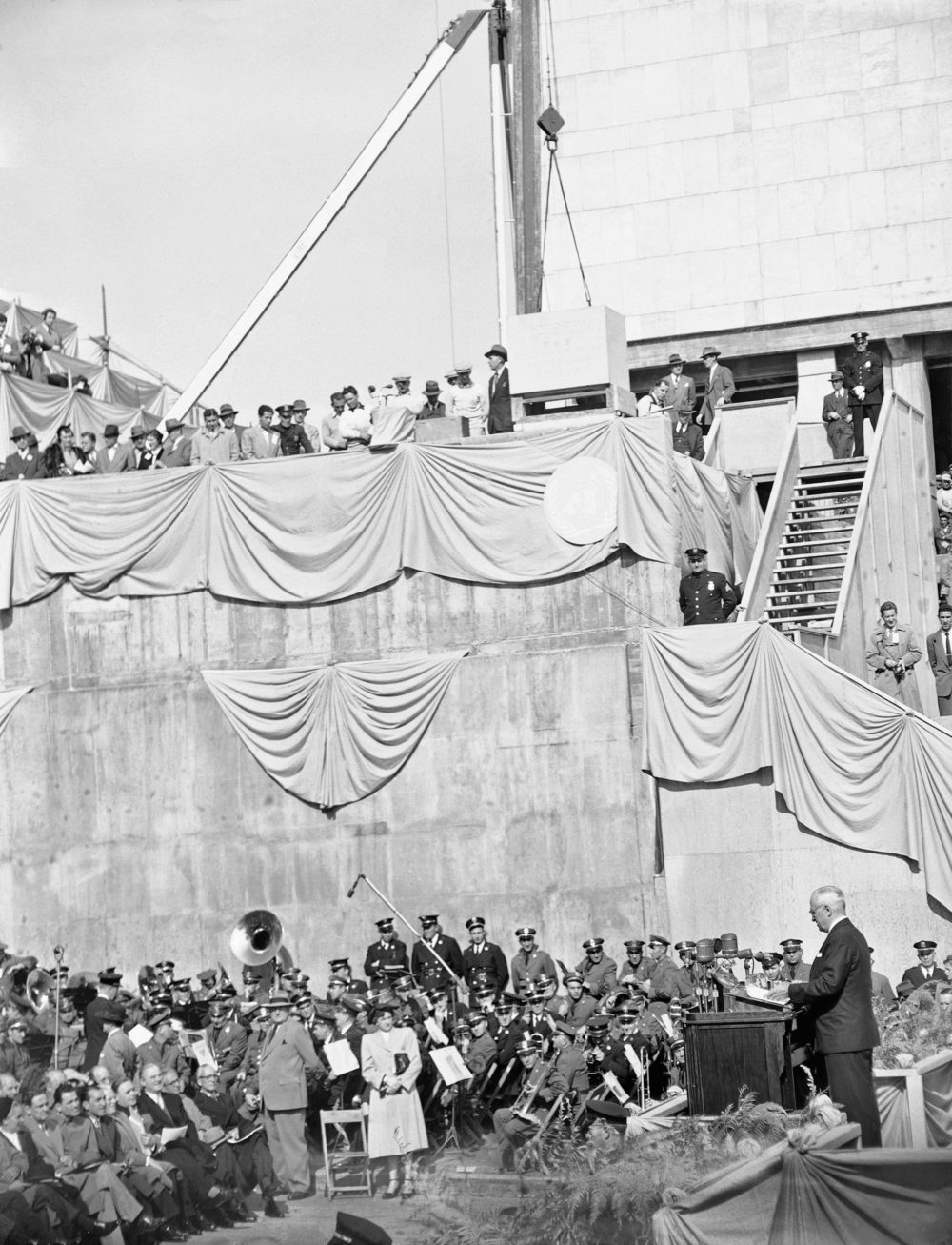President Harry S. Truman (right), delivers a foreign policy speech at the cornerstone laying ceremony for the United Nations permanent headquarters on Oct. 24, 1949 in New York City.   High above musicians is the cornerstone which was lowered into place over a receptacle containing a copy of the U.N. charter and the U.N. declaration of human rights. (AP)