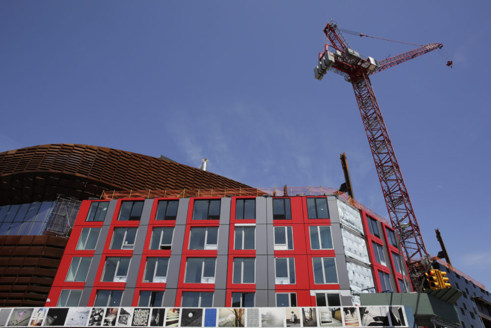A construction crane towers over a modular apartment building next to the Barclay's Center, Monday, May 5, 2014 in the Brooklyn borough of New York. (AP Photo/Mark Lennihan)