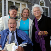 In this Sept. 21, 2013 photo, former President George H.W. Bush, front left, former first lady Barbara Bush, right, pose for photos after the wedding of longtime friends Helen Thorgalsen, center, and Bonnie Clement, in Kennebunkport, Maine. Bush was an official witness at the same-sex wedding, his spokesman said Wednesday, Sept. 25, 2013. (Susan Biddle/AP)