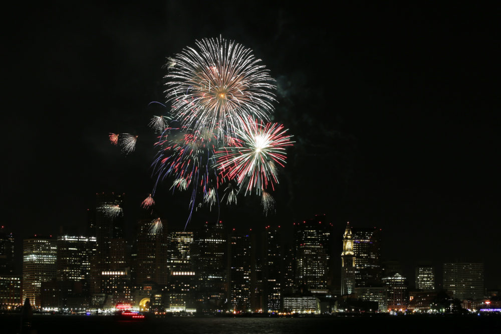 Fireworks light up the sky over Boston Harbor to celebrate First Night in Boston, Wednesday, Jan.1, 2014. (Elise Amendola/AP)