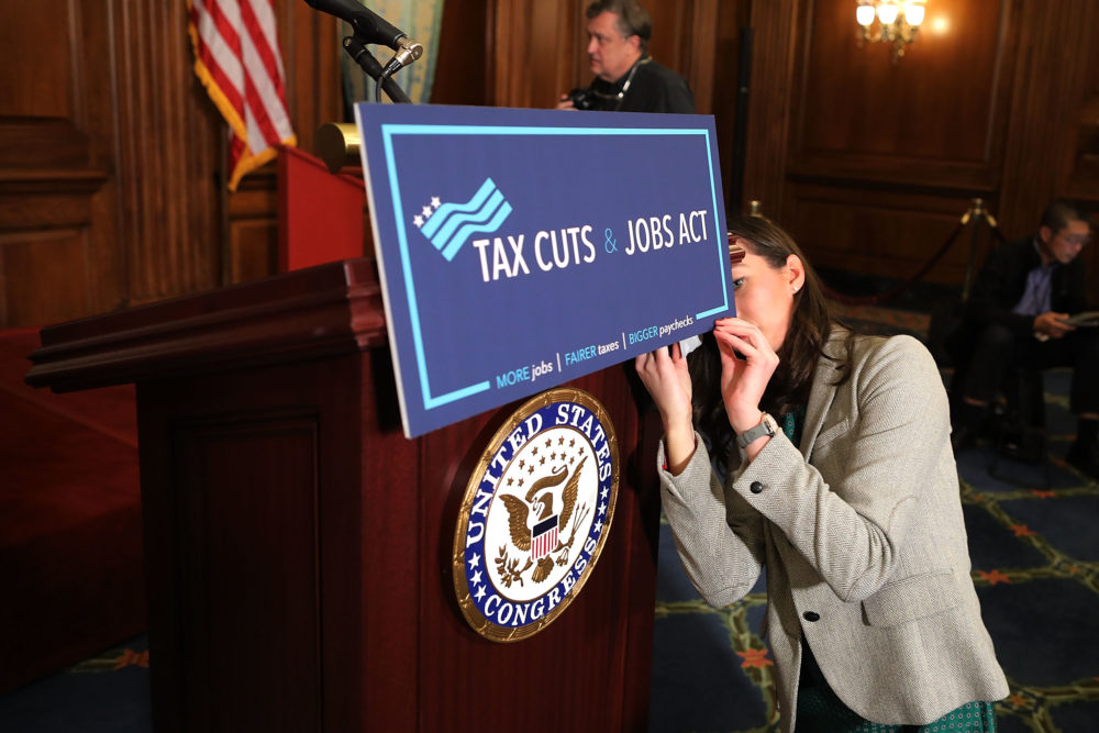 A staffer for Speaker of the House Paul Ryan prepares signage as the House votes on the Tax Cuts and Jobs Act at the U.S. Capitol on Nov. 16, 2017 in Washington, D.C. (Chip Somodevilla/Getty Images)